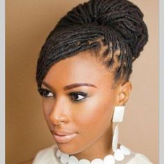 beautiful loc bun hair style for brides