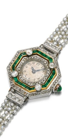 Lady's emerald, seed pearl and diamond wristwatch, early 20th century The octagonal dial applied with Arabic numeral indicators, the bezel set with step-cut emeralds and circular-cut and rose diamonds, the winding crown set with a cabochon emerald, to a seed pearl bracelet, length approximately 140mm, French assay marks.
