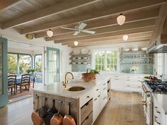 natural wood beams, floors, blue tile + painted trim