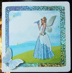 """Fairy Paloma on Craftsuprint designed by Mishara Armenia - made by Gwyneth George - I took one of the fairy images together with a background from kit cup426834_1056 into one of my graphics packages and re-sized and colourised a bit until I had a layout for a card topper of about 4"""" square I was happy with. I also put a second copy of the fairy on the other side of my working area so that I'd have a layer to decoupage once it was printed off. I printed onto 300gsm Super Smooth white ..."""