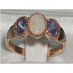 opal & tanzanite  my two favorite gems together.. heaven help me