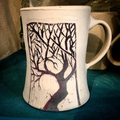 This from my last batch of mugs of the year. It has an uncharacteristically ( for me)shorter handle.  #tree #mug #mugshot #cup #branches  #porcelain  #pottery  #sgraffito  #surfacedecoration #ceramica  #ceramics  #keramik  #keramiikka  #keramisch #seramika #clay #ceramique #blackandwhite #slipcarving