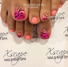 Tiger stripe inspired toenail art. Thin tiger stripe shaped lines are painted over salmon and fuchsia colored polishes. The base colors are alternately painted in salmon and a combination of fuchsia colors for effect.