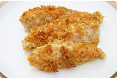 RANCH CHICKEN Combine: 3/4 cup crushed cornflakes. 3/4 cup parmesan cheese. 1 packet of hidden valley ranch dressing mix.     Dip 8 chicken halves in melted butter and then roll in cornflake mix. Place in greased 9x13 pan. Bake @ 350 for 45 min.