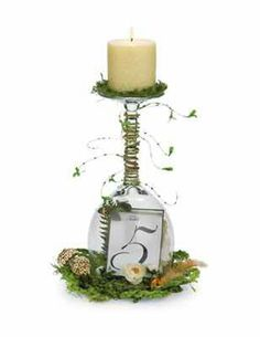 Wedding Centerpiece idea from Micheal's.com  Wine glass, Candle, Moss, Table numbers