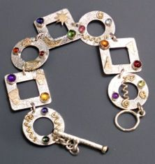 Sterling silver, 14ktgf accents and colored gemstones, one of my favorite pieces of jewelry!