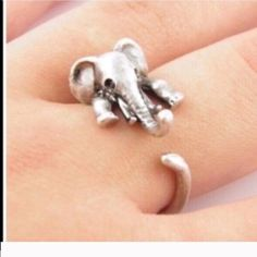 Elephant ring New in packaging. Metal is zinc alloy. Band is adjustable. No trades Jewelry Rings