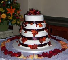 Fall Wedding Cake with some beautiful silk leaves and brown satin ribbon.