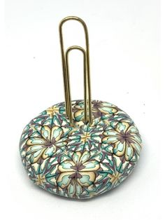 Covered with a kaleidoscope cane (no it's not painted), this paperweight is a beautiful accent to and desk or shelf. Oversize gold paper clip holds notes or pictures. Purple Gold, Teal, Gold Paper, Paper Clip, Paper Weights, Polymer Clay Jewelry, Objects, Unique, Painting