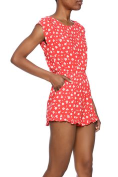 Red floral print romper with back tie detail elastic waist short sleeves round neckline and side pockets.  The Maggie Romper by Rosette. Clothing - Jumpsuits & Rompers - Rompers Minneapolis Minnesota