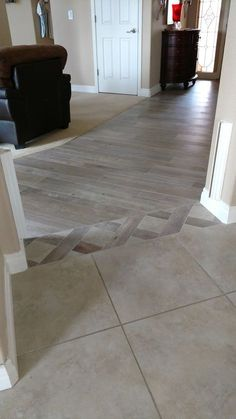 Tile transition from family room to kitchen.