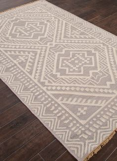 Inspired by the patterns and motifs of southeast asia, the batik collection is a modern take on this traditional textile art. - Color: Gray/Ivory - Material: 100% Wool - Shipping: Ships within 5-7 days. US only. - Return: This item is return eligible within 14 days.