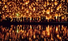 Release a candle at Yi Peng Festival in Thailand.