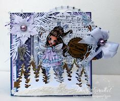 Creadin  Products: Joy! Crafts Round nr2, twigs and ice crystal - Magnolia, Tim Holtz Christmas Trees, Poinsettia - Spellbinders??;  Copics: Skin: E000-00-11-13; Eyes: B000-01; Hair: E29-25-21-50; Pink: V000-91-93-95; Blue: B0000-00-01; W00-wings 1-3