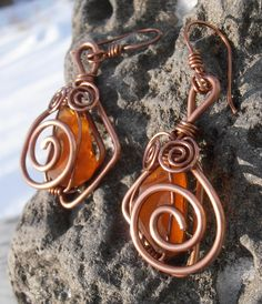 Here is my new earings design. I have to pat myself on a shoulder for this pair. I absolutely adore these. Love everything about them. Hope they will go to good hands..:) Material I used was thick natural copper jewellery wire and orange Cape Breton sea glass. Price is 35$ (+4$ S/H if mailed). If you want to check out more of my work, please visit Petra Designs facebook page.