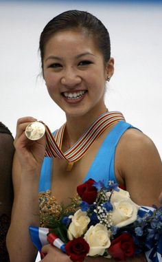 Michelle Kwan showing off her gold medal at the World Figure Skating Championships, March, 2003.