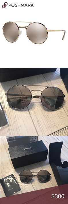 Prada PR51SS New! Still not sure if I want to let go of these...  absolutely stunning, chic, effortless.  Not sold on how they look on me though.  Purchased from Macy's , will send proof of purchase (sticker on box)  authentic!!!  Not the retail picture! the frames are silver and the tortoise shell print is like purplish/gray.  offers are welcome. Prada Accessories Sunglasses