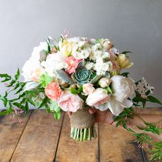 bouquet of peonies, garden roses, bellflower, ranunculus, parrot tulip, flowering onion, jasmine and succulents by Tulipina