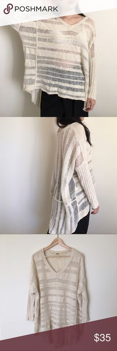 Free People Oversized High-Low Knit Sweater -Cream A grungy pullover v-neck sweater. Super oversized with long sleeves. Drapey high-low hem gives this sweater the prettiest ethereal look. Great layering piece that can be dressed up or down! Marked Petite, but fits Standard. ☁️☁️ Free People Sweaters