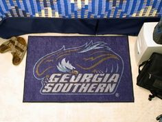 """Georgia Southern Starter Rug 20""""x30"""" by Fanmats. $13.68. Georgia Southern Starter Rug 20""""x30""""Decorate your home or office with area rugs by FANMATS. Made in U.S.A. 100% nylon carpet and non-skid recycled vinyl backing. Officially licensed and chromojet printed in true team colors. Please note: These products are custom made. The normal lead time is about 7-10 business days. However, the putting mats and carpet tiles do take a little longer, about 14-21 business days.***This i..."""