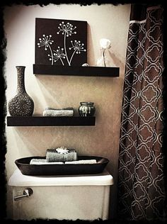 Love the look over the toilet. I would straighten up the shelves though.