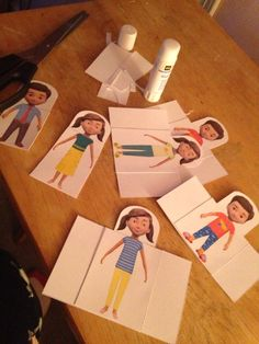 Caleb and Sophia paper dolls being made into bookmarks for the kids at the hall