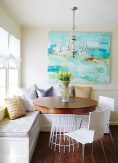 DESIGNER Virginia Volman    In this breakfast nook, Virginia reinvented an antique table by adding a new, modern base from Southeastern Salvage