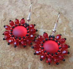 Earrings with red cabochons