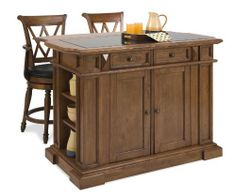 Home Styles Deluxe Island and Two Bar Stools, Oak Finish by Home Styles. $1419.99. Self-closing drawers and doors with hidden european hinges on doors, drawers have removable dividers for added convenient storage. Convenient drop leaf that rises to provide dining / serving space. Antique nickel hardware and easy glide storage drawer. Black 3/4-inch granite inset top. Raised detail cabinet doors with adjustable shelves inside. Deluxe traditions island and two stools- home styles ...