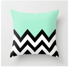 Stunning black & white chevron pillow with pastel green pop!