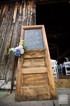 This old & vintage door was reused as a restaurant menu by simply adding a chalkboard. Simple & nice!
