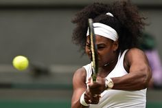 US player Serena Williams returns to US player Venus Williams during their women's singles fourth round match on day seven of the 2015 Wimbledon Championships at The All England Tennis Club in Wimbledon, southwest London, on July 6, 2015.  Serena Williams won the match 6-4, 6-3.