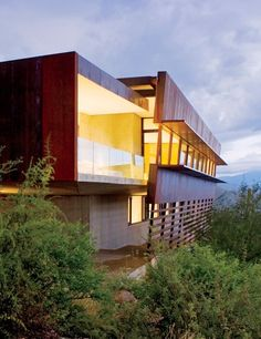 A wealth of coolness:  5 BEDROOMS  5.5 BATHS  6,500 SQ. FT.  $ 5.6 million PEDIGREE: Crafted by architect Rick Joy in 2007, this steel-clad home is nestled in the foothills of the Santa Catalina Mountains. The second story, partly cantilevered, contains expansive living and dining areas that are enhanced by a horizontal sweep of windows. The master suite is tucked into the concrete ground level.