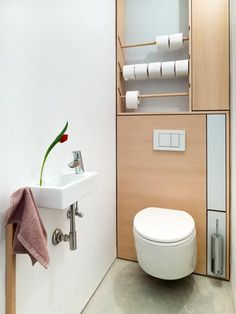 Prettiest toilet paper storage ever! And it free up space under the sink or in the linen closet!