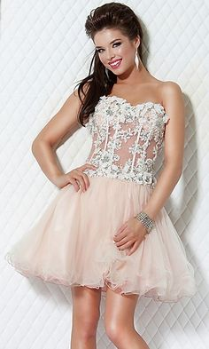I love the corset look of it all and wouldn't mind it actually being my homecoming dress. Though the sheer apeal of the color, I don't really like.