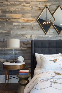 Contemporary farmhouse bedroom with rustic wood accent wall and modern furniture