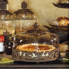 Showcase your favorite creations in style with this gorgeous old world style pie plate from the GG Collection. Handcrafted of ceramic and aluminum with a glass dome, the ceramic plate is removable and...