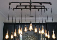 This gorgeous 14 Pendant Light Industrial Chandelier is constructed from black steel pipe, iron fittings, and cloth-covered twisted lamp cord leading down to black nickel finished lamp sockets, giving it that industrial turn of the century look. Additionally, each socket has its own rotary... - Madeofmillions.com