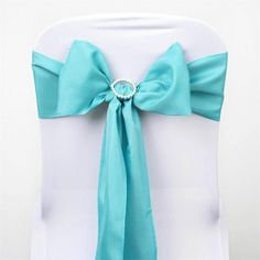 Turquoise Polyester Sash | eFavorMart /  Plan as many events as you want and invite as many guest as you desire without even worrying about the expenses and your budget. With our sturdy and economical polyester chair sashes, you can now transform any dining experience into a magnificent feast with an upscale feel and an elite look without breaking the banks. Get inspired by our premium quality polyester chair sashes that open the gates of creativity and ingenuity. With such a high standard…
