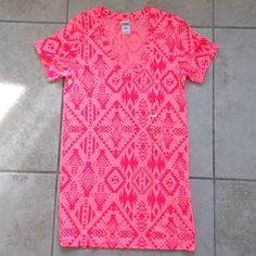 VS Pink Aztec T Neon pink with dark pink printing. V neck. Doesn't  have main tag but does still have size tag. Never worn, no damage, pulls etc. happy poshing! PINK Victoria's Secret Tops Tees - Short Sleeve