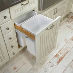 Pullout trash cans for the kitchen.