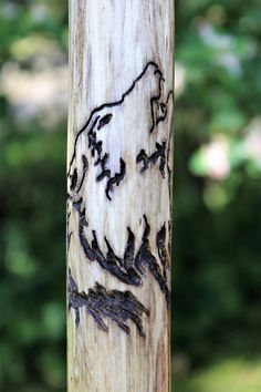 Hand carved hiking stick for the nature lover with a howling