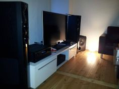We like the mood lighting in this home theater shot. And the Ultra towers and PB-1000 too!