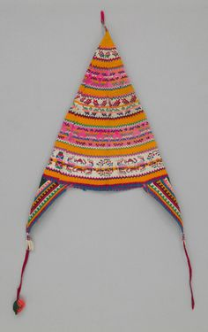 Of Peruvian or Bolivian origin, these hats are knit with very small needles, traditionally made of bicycle spokes.