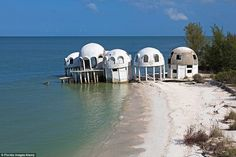 Built in the early 1980s, these solar-powered dome homes in Cape Romano, Florida, were occupied for ten years, but 1992's Hurricane Andrew caused damage in the area. Then in 2005, Hurricane Wilma damaged the houses and tore away part of the coastline. Today, the houses can only be reached by boat