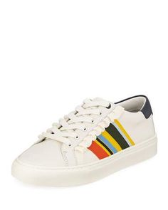 """Tory Sport Tory Sport Ruffle Striped Low-Top Sneaker $228 Tory Sport cow leather sneaker with striped and ruffled cotton trim and side stripes. 1"""" platform heel. Round toe. Lace-up vamp. Contrast logo backstay. Padded footbed. Rubber outsole. Imported."""