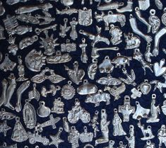 Silver Tone Milagros. Milagro charms. I will send assorted milagros bunch. not all from the pics but assorted selection.   eBay!