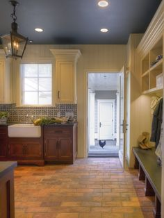 Now there's an idea - keeping the walls light to brighten up the kitchen, and doing dark ceiling to match the color tile backdrop & adding warm tile flooring...
