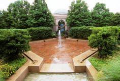 The Fountain Garden in the Enid A. Haupt Garden was inspired by the Court of the Lions in the Alhambra, the 12th century fortress and palace in Granada, Spain.