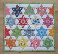 (love how the fabric designs were used to accentuate the star design of the quilt.)